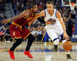 Warriors guard Stephen Curry drives past Cavaliers guard Kyrie Irving Jan. 9 in Oakland, Calif. The Warriors won 112-94.