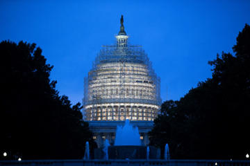 Scaffolding surrounds the U.S. Capitol Building while it undergoes repairs in Washington, D.C., U.S., on Wednesday, Nov. 5, 2014. Republicans roared back in the midterm elections on Tuesday, capturing control of the Senate from Democrats, winning crucial governor races and solidifying their majority in the U.S. House.