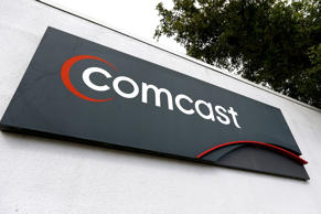 A Comcast sign is seen at one of their centers on February 13, 2014 in Pompano Beach, Florida. Joe Raedle/Getty Images