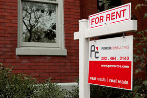 A POWERConsulting & Real Estate for rent sign stands in front of a row house in the Logan Circle neighborhood of Washington, D.C., U.S., on Sunday, March 25, 2012. Andrew Harrer/Bloomberg/Getty Images