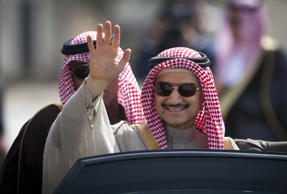 Saudi billionaire Prince Alwaleed bin Talal waves as he arrives at the headquarters of Palestinian President Mahmoud Abbas in the West Bank city of Ramallah, Tuesday, Feb. 4, 2014.