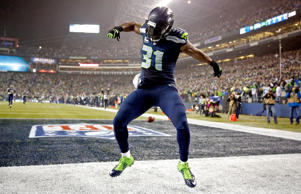 Kam Chancellor of the Seattle Seahawks celebrates after scoring a 90-yard touchdown off of an interception against the Carolina Panthers in the NFC Divisional Playoff game on Jan. 10, 2015, at CenturyLink Field in Seattle.