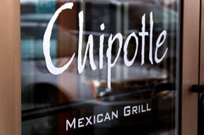 This Tuesday, Jan. 28, 2014, file photo, shows the door at a Chipotle Mexican Grill in Robinson Township, Pa. Gene J. Puskar/AP