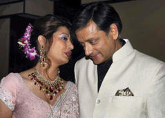 File: In this Sept. 4, 2010 file photo, former Indian Junior Foreign Minister Shashi Tharoor listens to his wife Sunanda Pushkar at their wedding reception in New Delhi, India. Pushkar died from stress and the wrong medication — not suicide, her son said in media reports Wednesday, Jan.22, 2014, the latest twist in a case that has captivated the country.
