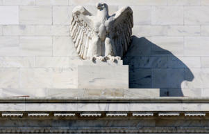 An eagle sculpture over the entrance the Federal Reserve building in Washington