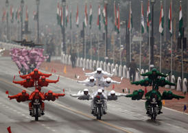 "File: India's Border Security Force (BSF) ""Daredevils"" motorcycle riders perform stunts as they take part during the Republic Day parade in New Delhi January 26, 2015. India celebrated its 66th Republic Day on Monday."