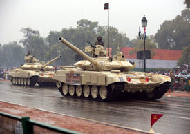 File: Tanks move along the Republic Day Parade route in New Delhi, India, Monday, Jan. 26, 2015. President Barack Obama is the Chief Guest for this year's parade.