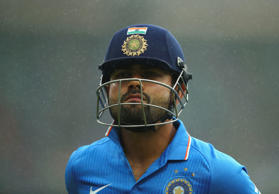 Virat Kohli of India leaves the ground after rain stopped play during the One Day International match between Australia and India at Sydney Cricket Ground on January 26, 2015 in Sydney, Australia.