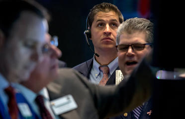 A trader works on the floor of the New York Stock Exchange Jan. 23, 2015.