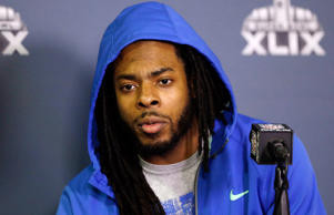 Seattle Seahawks' Richard Sherman answers a question at a news conference for NFL Super Bowl XLIX football game on Jan. 25, 2015 in Phoenix.