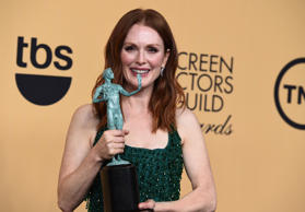 Julianne Moore poses in the press room with the award for outstanding performance by a female actor in a leading role for Still Alice.