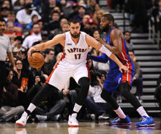 Toronto Raptors center Jonas Valanciunas (17) holds off Detroit Pistons forward Greg Monroe (10) in the first quarter at Air Canada Centre. Toronto won 114-110.