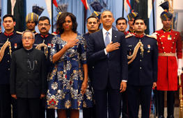File: VU.S. President Barack Obama and first lady Michelle Obama place their hands over their hearts during the playing of the U.S. National Anthem at a receiving line with India's President Pranab Mukherjee (front L) before the start of an official Indian State Dinner for Obama at the Rashtrapati Bhavan presidential palace in New Delhi January 25, 2015. Obama is visiting India for three days to attend Republic Day celebrations and meet with Indian leaders.