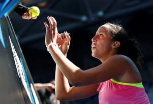 Madison Keys of the U.S. signs autographs after defeating compatriate Madison Brengle to win their women's singles fourth round match at the Australian Open 2015 tennis tournament in Melbourne January 26, 2015.