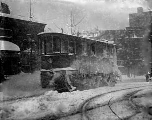 A trolley pushes through the snow and ice brought by the Great Blizzard of 1888, Washington, DC.
