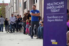 This photo provided by the Service Employees International Union shows people waiting to enter an Affordable Care Act enrollment event sponsored by SEIU-United Healthcare Workers West and Community Coalition, in Los Angeles Saturday, Nov. 15, 2014.