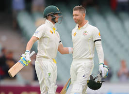 Michael Clarke of Australia is congratulated by Steven Smith as he reaches his century during day two of the First Test match between Australia and India at Adelaide Oval on December 10, 2014 in Adelaide, Australia.
