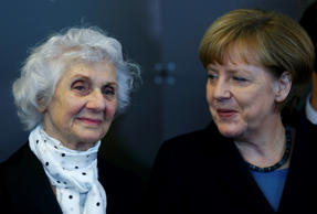 German Chancellor Angela Merkel, right, and Auschwitz survivor Eva Fahidi attend the opening event for the international remembrance of the 70th anniversary of the Liberation of Auschwitz in Berlin January 26, 2015.