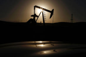 A pump jack is seen at sunrise near Bakersfield, California in this October 14, 2014 file photo.