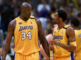 Los Angeles Lakers' Shaquille O'Neal, left, and Kobe Bryant talk it up during a break of Game 6 of the NBA Finals against the Indiana Pacers at the Staples Center Friday June 16, 2000. It's become clear this week that all is not well with the defending champion Los Angeles Lakers because O'Neal and Bryant - perhaps the NBA's two best players - are having problems seeing eye-to-eye.