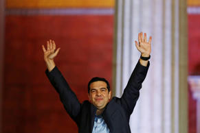 Alexis Tsipras, leader of the Syriza party, waves to supporters at Athens University following election victory in Athens, Greece, Jan. 25, 2015.
