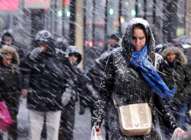 Pedestrians make their way through driving snow in midtown Manhattan in New York, Monday, Jan. 26, 2015. More than 35 million people along the Philadelphia-to-Boston corridor rushed to get home and settle in Monday as a fearsome storm swirled in with the potential of 1 to 3 feet of snow that could paralyze the Northeast for days.