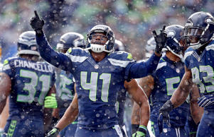 Byron Maxwell (41) of the Seattle Seahawks celebrates after a play against the Green Bay Packers during the NFC Championship game on Jan. 18, 2015, at CenturyLink Field in Seattle.