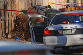 Denver police shot and killed a female suspect early Monday after they said she drove a stolen car at officers, hitting one of them in the leg, January 26, 2015. Neighbors described the driver as a teenager.