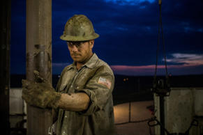 WILLISTON, ND - JULY 28:  Scott Berreth, a derrick hand for Raven Drilling, works on an oil rig drilling into the Bakken shale formation on July 28, 2013 outside Watford City, North Dakota.  North Dakota has been experiencing an oil boom in recent years, due in part to new drilling techniques including hydraulic fracturing and horizontal drilling. In April 2013, The United States Geological Survey released a new study estimating the Bakken formation and surrounding oil fields could yield up to 7.4 billion barrels of oil, doubling their estimate of 2008, which was stated at 3.65 billion barrels of oil. Workers for Raven Drilling work twelve hour days fourteen days straight, staying at a camp nearby, followed by fourteen days. (Photo by Andrew Burton/Getty Images)
