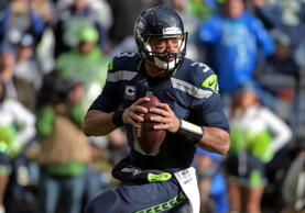 Seattle Seahawks quarterback Russell Wilson (3) looks downfield to throw during the second quarter against the Green Bay Packers in the NFC Championship Game at CenturyLink Field on Jan. 18, 2015.  Kirby Lee/USA TODAY Sports