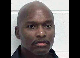 FILE - This undated provided by the Georgia Department of Corrections shows convicted murderer Warren Lee Hill. Georgia, the first state to pass a law prohibiting the execution of mentally disabled death row inmates, is revisiting a requirement for defendants to prove the disability beyond a reasonable doubt to be spared execution on those grounds _ the strictest burden of proof in the nation.