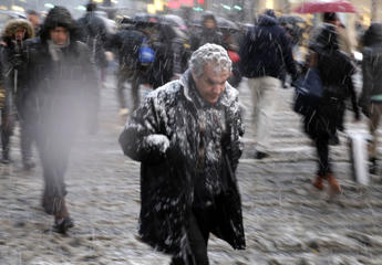Pedestrians make their way through snow in midtown Manhattan in New York.