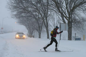 A woman cross country skis on snow covered roads during a blizzard in Boston, Massachusetts on January 27.