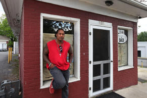 Mandrel Stuart stands in front of his former restaurant, The Smoking Rooster in Staunton, Virginia on May 20, 2014.