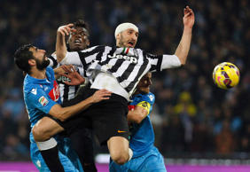 Juventus' Giorgio Chiellini (front) jumps for the ball during their match against Napoli in their Italian Serie A soccer match at the San Paolo stadium in Naples, January 11, 2015.