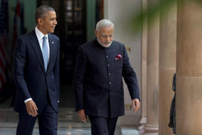 File: U.S. President Barack Obama walks with Indian Prime Minister Narendra Modi to be photographed by the media at the Hyderabad House in New Delhi, India, Sunday, Jan. 25, 2015.