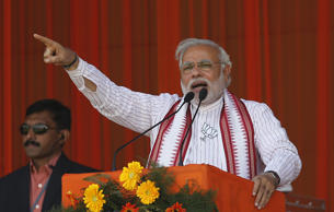 File: Hindu nationalist Narendra Modi, prime ministerial candidate for the main opposition Bharatiya Janata Party (BJP) and Gujarat's chief minister, addresses his supporters during a rally in Amroha, in the northern Indian state of Uttar Pradesh March 29, 2014.