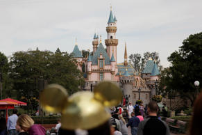 People walk toward the Sleeping Beauty's Castle in the background at Disneyland, Jan. 22, 2015, in Anaheim, Calif.