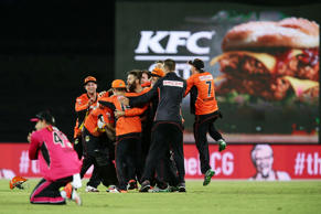 Perth Scorchers players celebrate victory at the end of the Big Bash League final match between the Sydney Sixers and the Perth Scorchers at Manuka Oval on January 28, 2015 in Canberra, Australia.