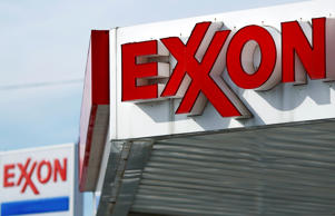 An Exxon gas station stands in Cincinnati, Ohio, U.S. on Monday, Jan. 27, 2014. Exxon Mobil Corp. is scheduled to release their fourth quarter earnings on Thursday, January 30, 2014.
