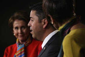 Rep. Ben Ray Luján (D-NM) speaks as House Minority Leader Rep. Nancy Pelosi (D-CA) listens during a news conference to announce new members of the House Democratic leadership team on Capitol Hill in Washington, DC, November 17, 2014.