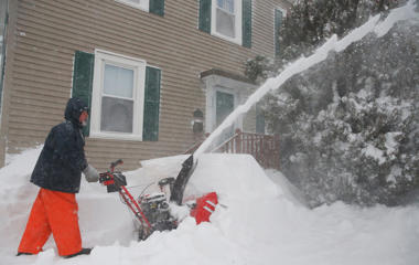 Kris Honkala, 50, tries to keep up with the snow at his home in Newburyport, Mass, January 27, 2015