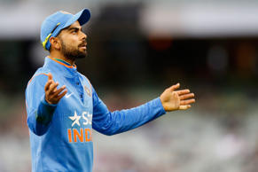 Virat Kohli of India gestures to the fans during the One Day International match between Australia and India at Melbourne Cricket Ground on January 18, 2015 in Melbourne, Australia.