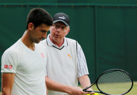 Novak Djokovic of Serbia listens to his coach Boris Becker, right, during a training session at the All England Lawn Tennis Championships in Wimbledon, London, Saturday, July 5, 2014.