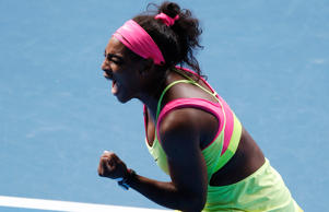 Serena Williams of the U.S. reacts after winning the first set against compatriot Madison Keys during their women's singles semi-final match at the Australian Open 2015 tennis tournament in Melbourne January 29, 2015.