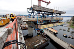 Construction continues on a balanced cantilever bridge section to meet one already built above the Lake Washington shoreline on the replacement highway 520 floating bridge Tuesday, Dec. 16, 2014, in Medina, Wash.