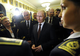 Russian President Vladimir Putin, center, meets with students and staff while visiting the National Mineral Resources University (University of Mines) in St. Petersburg, January 26, 2015.