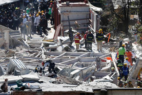 Emergency responders work at the site of an explosion at a maternity hospital in Mexico City