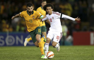 Mile Jedinak of Australia contests the ball with Omar Abdulrahman of The United Arab Emirates during the Asian Cup Semi Final match between the Australian Socceroos and the United Arab Emirates at Hunter Stadium.