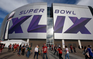 Fans walk outside University of Phoenix Stadium on January 25, 2015 in Glendale, Arizona